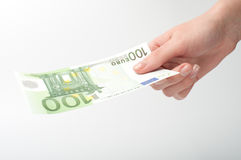 Close-up  Euro banknote in hand. Close-up of Euro banknote in woman's hand Stock Image