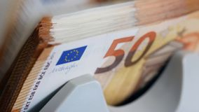 Close up of euro banknotes while being counted. 4K stock video