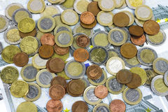 Close-up of Euro banknotes and coins Stock Photography