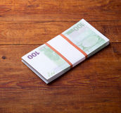Close-up of  100 Euro banknotes on wood background Royalty Free Stock Images