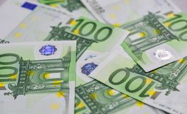 Euro banknotes 100 EUR. Close-up of 100 Euro bills banknotes money. European Union Currency Stock Image