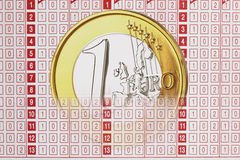 Close up of 1 euro coin on betting slip Royalty Free Stock Photo