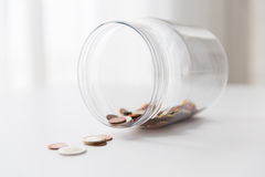 Close up of euro coins in glass jar on table Stock Photography