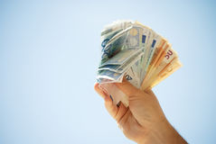 Income. Close up of euro money on a faded blue background Stock Photo