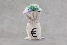 Close up of euro paper money in bag over concrete Royalty Free Stock Photos