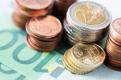 Close up of euro paper money and coins on table Royalty Free Stock Photo