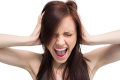 Close up on exasperated brunette screaming Stock Photo