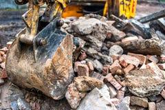 Close-up of excavator bucket loading rocks, stones, earth Stock Photography