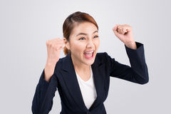Close-up of an excited businesswoman celebrating with arms up Stock Photography