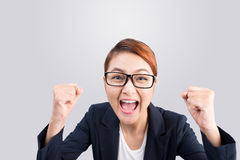 Close-up of an excited businesswoman celebrating with arms up Royalty Free Stock Photography