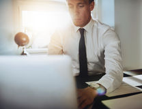 Close up of executive business man with laptop royalty free stock photography