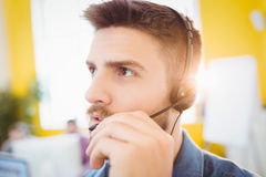 Close-up of executive interacting with headphones at creative office Royalty Free Stock Photos