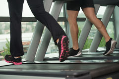 Close-Up Exercising On A Treadmill. Close Up Of Couples Legs Running On Treadmill - Blurred Motion Stock Photos