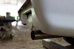 Close up exhaust pipe of car, shallow depth of field Royalty Free Stock Images