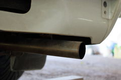 Close up exhaust pipe of car, shallow depth of field Royalty Free Stock Photos