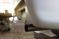 Close up exhaust pipe of car, shallow depth of field, sunshine effect Stock Images