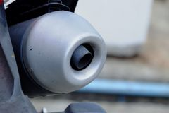 Close up a exhaust pipe of motorcycle. Parking in outdoor place and blur ground floor royalty free stock images