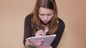 Close-up of an exhausted young woman working or preparing for her exam stock video footage