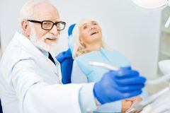 Close up of experienced dentist and satisfied patient royalty free stock photography
