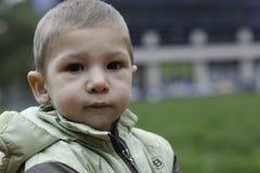 Close up exterior portrait of boy waring autumn jacket Stock Images