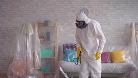 Close up of the exterminator is cleaning the room with a spray