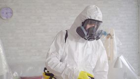 Close up of the exterminator cleans with a spray