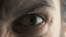 Close up eye of Angry serious man. Angry serious man with evil eyes stock video