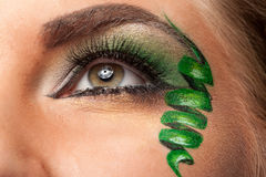 Close up of an eye with artistic make up Stock Photos