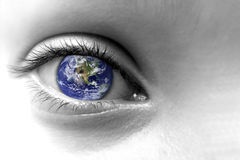 Close up of an eye with the earth in its iris Stock Photos