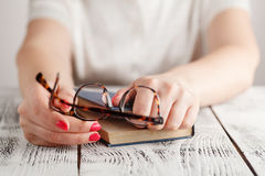 Close up of eye glasses on text book in library. Education concept Royalty Free Stock Photography