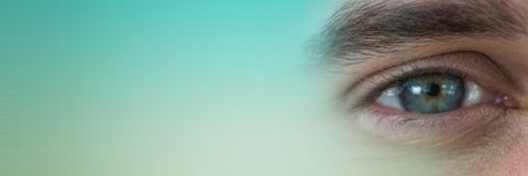 Close up of eye with green transition Stock Photography