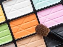 Close up eye make up brush on colorful eye shadow Stock Photo