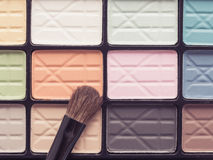 Close up eye make up brush on colorful eye shadow Royalty Free Stock Images