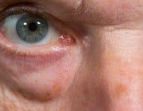 Close up of eye senior caucasian man. Macro close up of eye of a senior caucasian man with wrinkles and bags under eye Royalty Free Stock Images