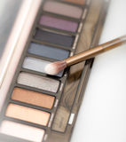 Close up of eye shadow powders and brush Royalty Free Stock Photography