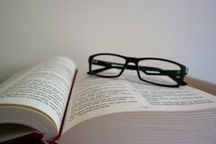 Close-up of Eyeglasses on Book Royalty Free Stock Photo