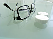 Close up of eyeglasses and contact lens case Royalty Free Stock Image