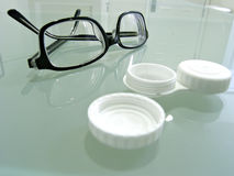 Close up  of eyeglasses and contact lens case Royalty Free Stock Photos