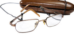 Close-up of eyeglasses next to its case. Close-up shoot of eyeglasses next to its case isolated on white background Stock Photo