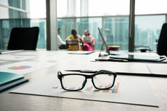 Close-up of eyeglasses on a printed bar chart showing progress Stock Image