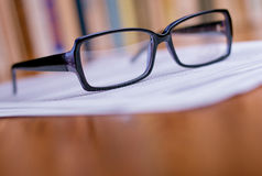 Close up Eyeglasses on Top of White Papers Stock Photos