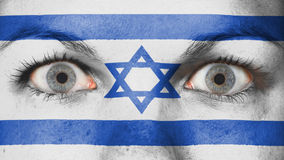 Close up of eyes with flag. Close up of eyes. Painted face with flag of Israel Stock Photos