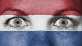 Close up of eyes with flag. Close up of eyes. Painted face with flag of Netherlands Royalty Free Stock Photos