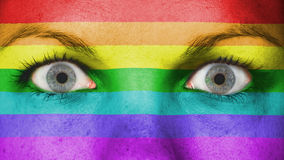 Close up of eyes with flag. Close up of eyes. Painted face with rainbow flag Stock Photography