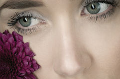 Close up of eyes and flower Royalty Free Stock Photography