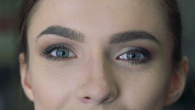 Close-up of eyes of a girl staring in the camera stock video