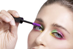 Close up on eyes , making colorful eyeshadows and eyeliner Stock Photo