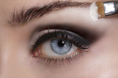 Close up on eyes , making colorful eyeshadows and eyeliner Stock Photography
