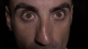Close up with eyes of man opening wide and showing surprised expression - stock footage