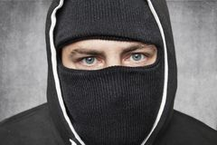 Close-up on the eyes, masked man remains incognito. Wearing black cloths Royalty Free Stock Photos